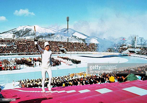 Final torch bearer Hideki Takada runs up the steps to light to the Olympic cauldron during the opening ceremony of the 1972 Sapporo Winter Olympics...