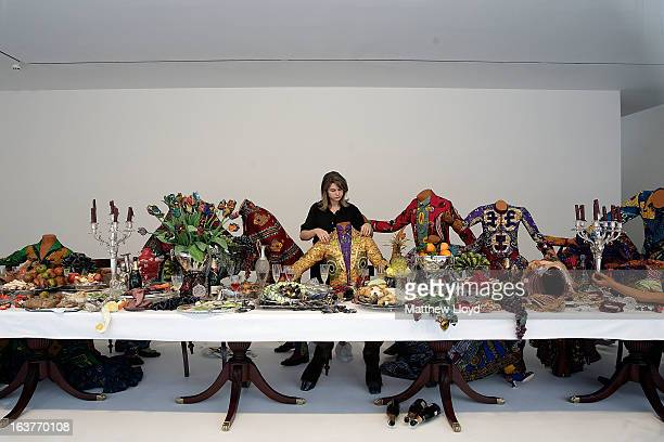 Final touches are put to 'The Last Supper ' part of the Pop exhbition by Yinka Shonibare MBE at the The Stephen Friedman Gallery on March 15 2013 in...