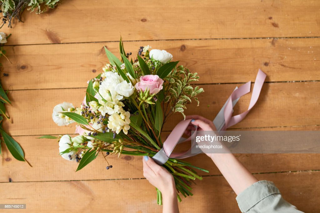 Final touches to make bridal bouquet : Stock Photo