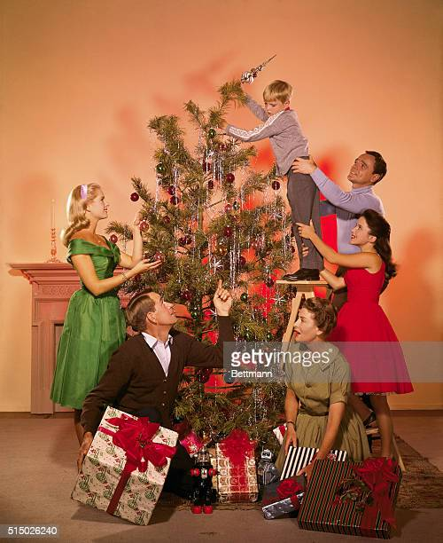Final touchto the Christmas tree ready's the National Velvet family for the big day Lori Martin Ann Doran James McCallion Arthur Space Carole Wells...