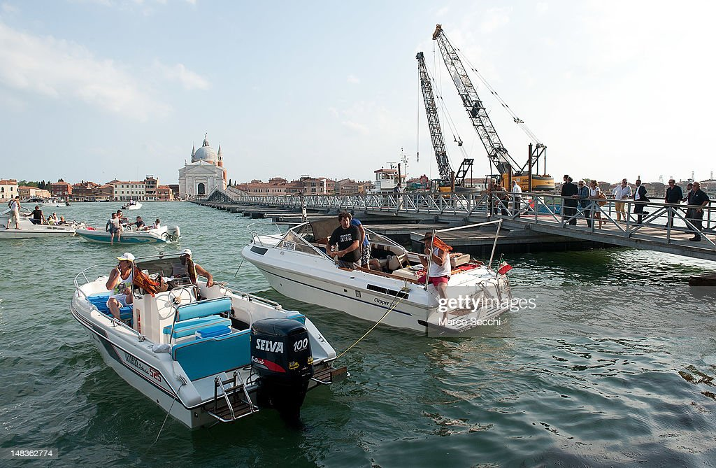 Final works for the preparation of the pontoon bridge for the Redentore Celebrations on July 14, 2012 in Venice, Italy. Redentore is one of the most loved celebrations by Venetians which is in remembrance for the end of the 1577 plague. Highlights of the celebration include the pontoon bridge extending across the Giudecca Canal, gatherings on boats in the St Mark's basin and a spectacular fireworks display.
