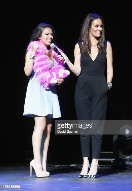Finalist Adelaine Morin and host Catt Sadler attend NYX FACE Awards 2014 Presented by NYX Cosmetics at Club Nokia on August 22 2014 in Los Angeles...