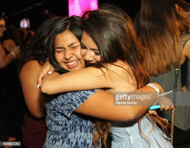Finalist Adelaine Morin with a fan attend NYX FACE Awards 2014 Presented by NYX Cosmetics at Club Nokia on August 22 2014 in Los Angeles California
