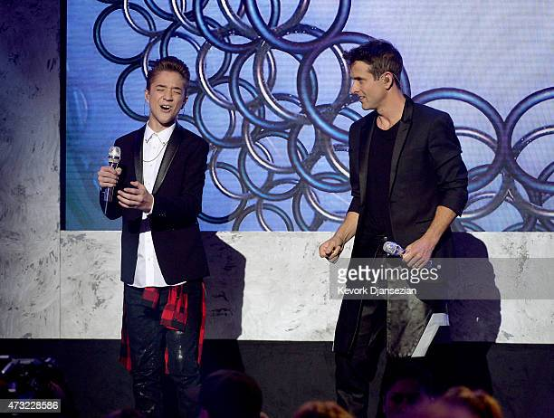 Finalist Daniel Seavey and singer/songwriter Joey McIntyre of NKOTB perform onstage during American Idol XIV Grand Finale at Dolby Theatre on May 13...