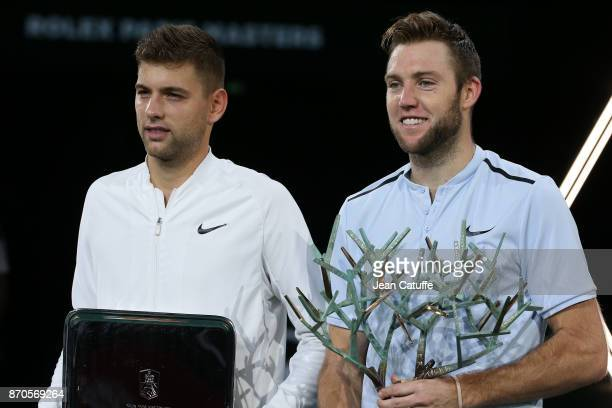 Finalist Filip Krajinovic of Serbia winner Jack Sock of USA during the trophy ceremony following the final on day 7 of the Rolex Paris Masters 2017 a...