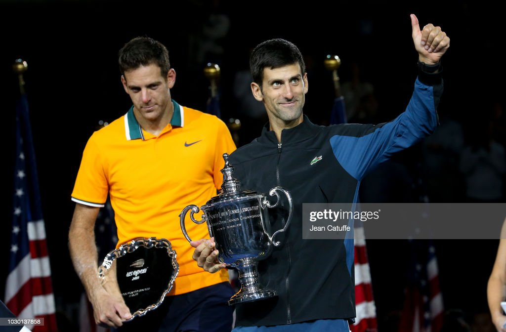 Finalist Juan Martin del Potro of Argentina, winner Novak Djokovic of Serbia during the trophy ceremony following the men's final on day 14 of the 2018 US Open at Arthur Ashe Stadium of USTA Billie Jean King National Tennis Center on September 9, 2018 in Flushing Meadows, Queens, New York City.