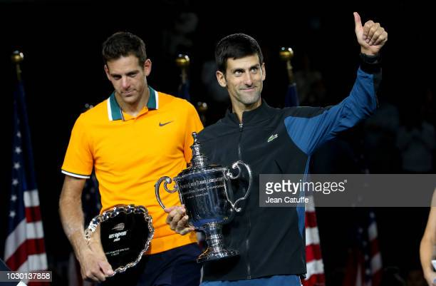 Finalist Juan Martin del Potro of Argentina winner Novak Djokovic of Serbia during the trophy ceremony following the men's final on day 14 of the...