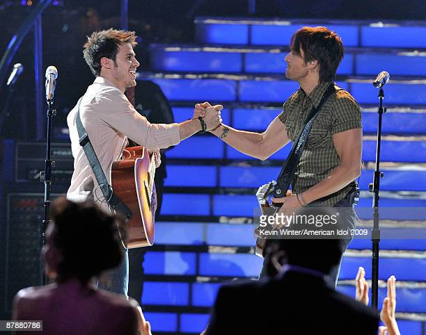 Finalist Kris Allen and musician Keith Urban perform onstage during the American Idol Season 8 Grand Finale held at Nokia Theatre L.A. Live on May...