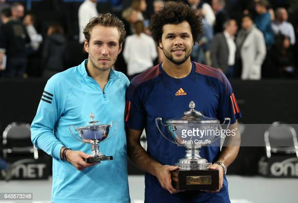 Finalist Lucas Pouille of France and winner Jo-Wilfried Tsonga of France pose during the trophy ceremony following their final at the Open 13, an ATP...