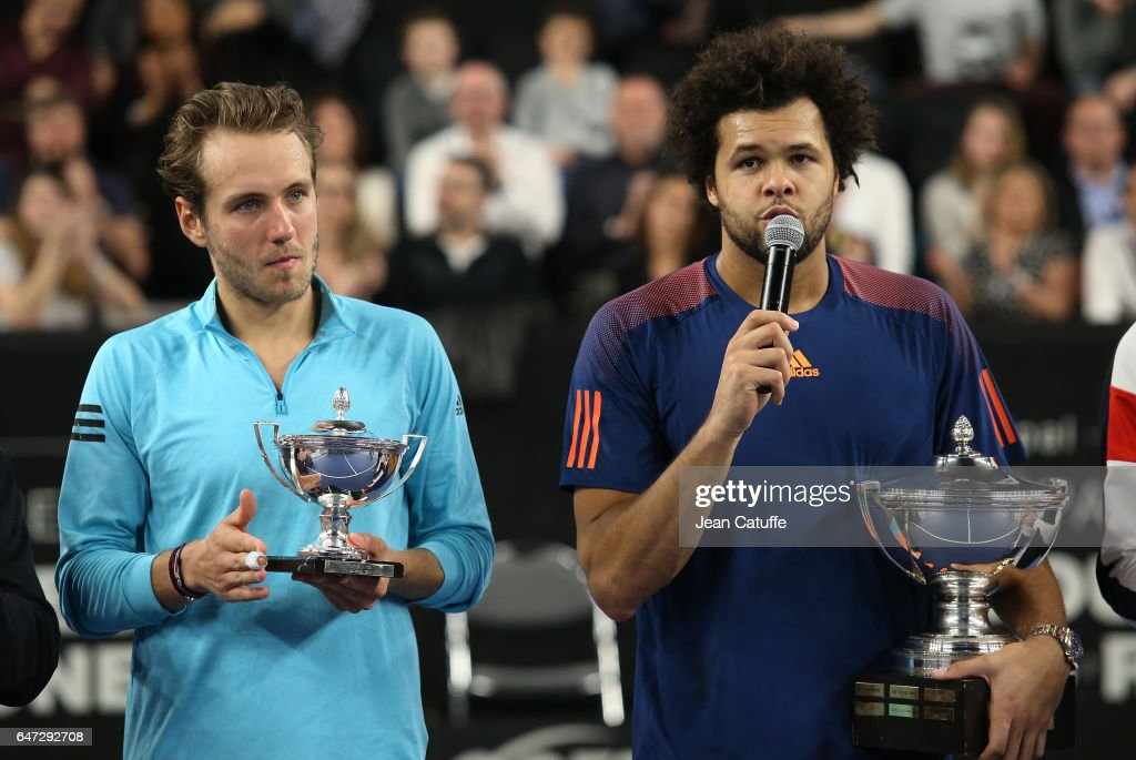 Finalist Lucas Pouille of France and winner Jo-Wilfried Tsonga of France pose during the trophy ceremony following their final at the Open 13, an ATP 250 tennis tournament at Palais des Sports on February 26, 2017 in Marseille, France.