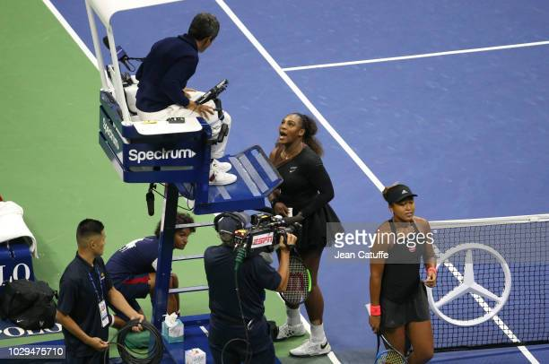 Finalist Serena Williams of USA has a final word with umpire Carlos Ramos of Portugal while winner Naomi Osaka of Japan looks on following the...
