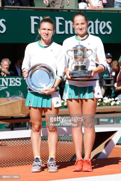 Finalist Simona Halep and Winner of the Women Final Jelena Ostapenko pose with their Cups after the Women Final of the 2017 French Tennis Open Day...