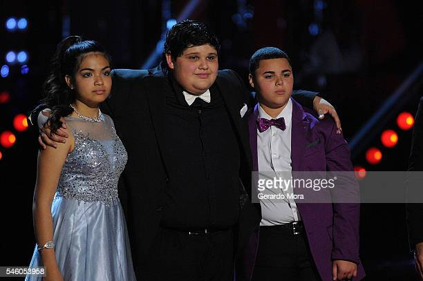 Finalists Alejandra Gallardo Christopher Rivera and Axel Cabrera stand together during Telemundo 'La Voz Kids' Finale at Universal Orlando on July 9...
