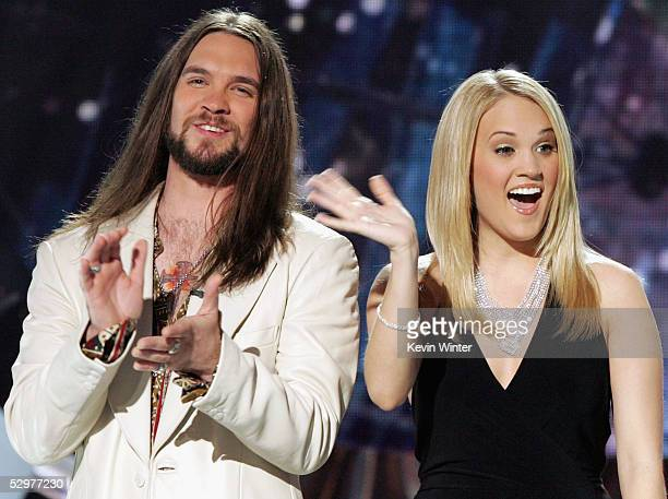 Finalists Bo Bice and Carrie Underwood appear onstage with host Ryan Seacrest at the 'American Idol' final performance show at the Kodak Theatre on...
