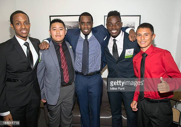 Finalists Dagim Girma and Juny Nguyen Rapper/Entrepreneur Sean 'Diddy' Combs and Finalists Toheeb Okenla and Jesus Fernandez attend the 2013 National...