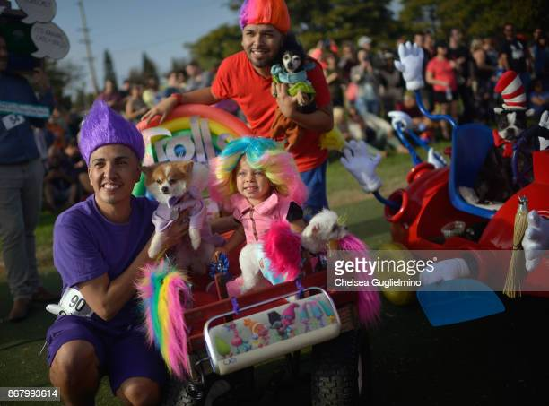 Finalists dressed as Trolls pose at the Haute Dog Howl'oween Parade on October 29 2017 in Long Beach California