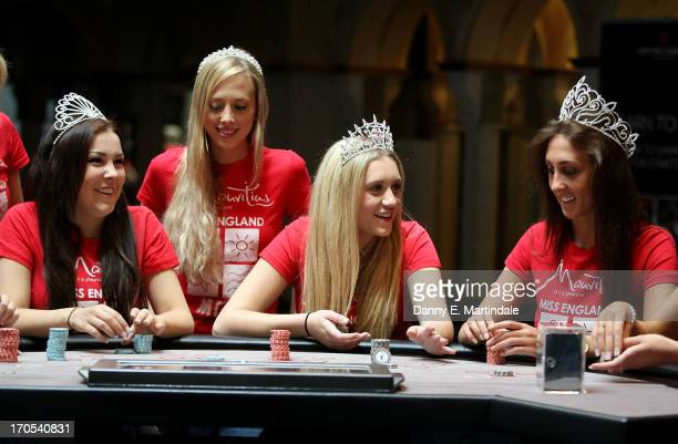 Finalists for Miss England 2013 play at the blackjack table at Genting Casino on June 14 2013 in Torquay England