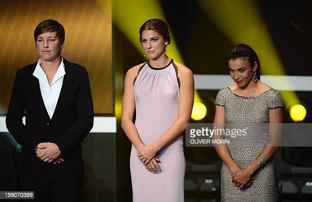 Finalists for women's footballer of the year US forward Abby Wambach US forward Alex Morgan and Brazil's forward Marta stand on stage during the FIFA...