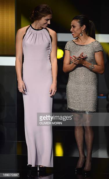 Finalists for women's footballer of the year US forward Alex Morgan and Brazil's forward Marta stand on stage during the FIFA Ballon d'Or awards...