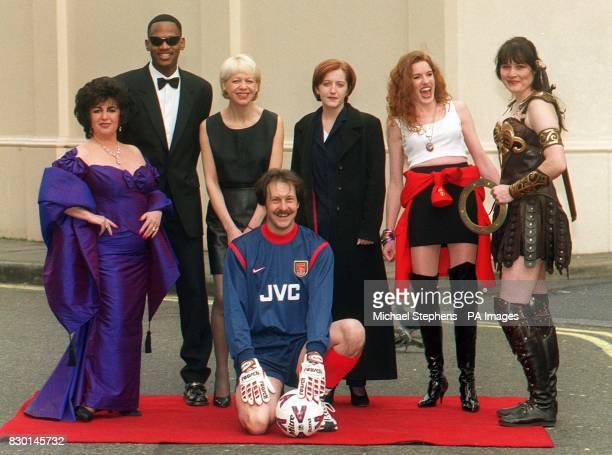 Finalists in a celebrity lookalike contest pose for the media outside London's Madame Tussaud's Twenty hopefuls are competing for a 12month contract...
