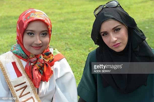 Finalists of Muslim beauty pageant of the 2014 World Muslimah Awards Nur Khairunnisa Gesti Nur Ula Deraputri of Indonesia and Ben Guefrache Fatma of...