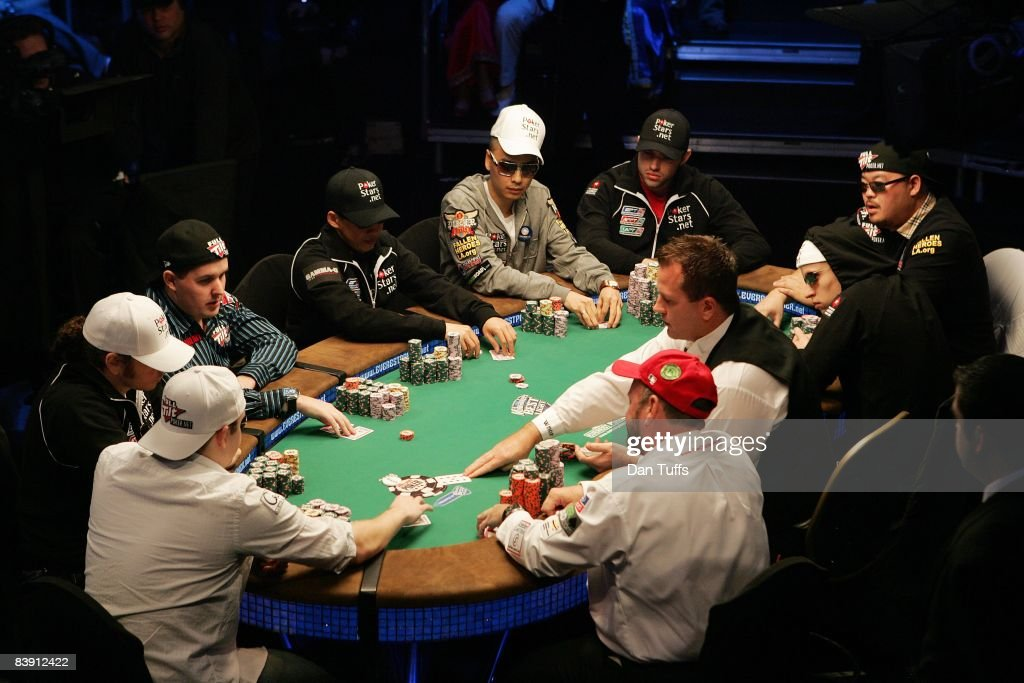 Finalists playing the final table of the World Series of Poker, Clockwise from red cap -Dennis Phillips, Craig Marquis,Ylon Schwartz, Scott Montgomery, Darus Suharto,DavidReheem,Ivan Demidov,Kelly Kim and Peter Eastgatein Las Vegas, Nevada on November 9, 2008.