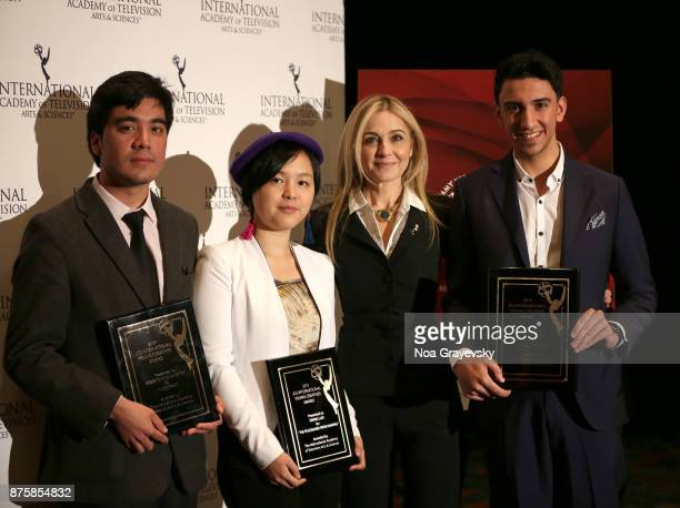 Finalists Roberto Pino Almeyda Ewing Luo Eisa Alhabib pose for a photo with Michal Grayevsky President JCS International during the Nominee Medal...