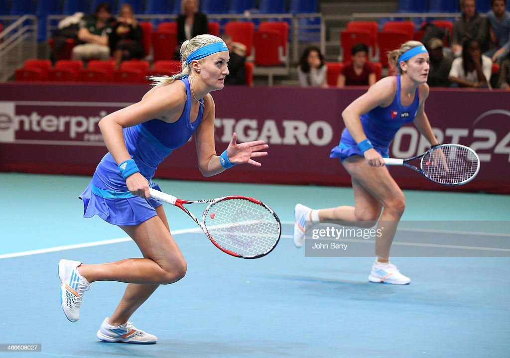 Finalists Timea Babos of Hungary and Kristina Mladenovic of France in action during the doubles final of the 22nd Open GDF Suez held at the Stade de Coubertin on February 2, 2014 in Paris, France.