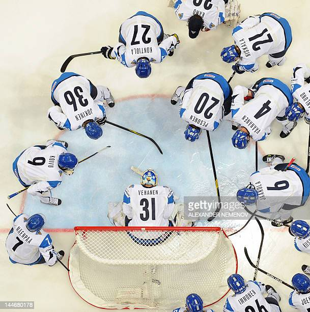Finalnd's players gather around their goalkeeper before the quarterfinal ice hockey game of the IIHF International Ice Hockey World Championship in...