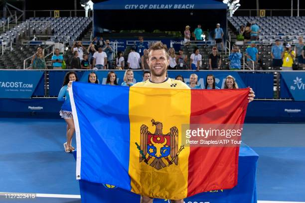 Finals champion Radu Albot of Moldova poses with the Moldova flag after defeating Daniel Evans of Great Britain at the Delray Beach Open held at the...