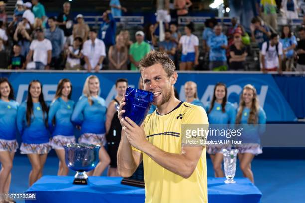 Finals champion Radu Albot of Moldova poses with the trophy after defeating Daniel Evans of Great Britain at the Delray Beach Open held at the Delray...