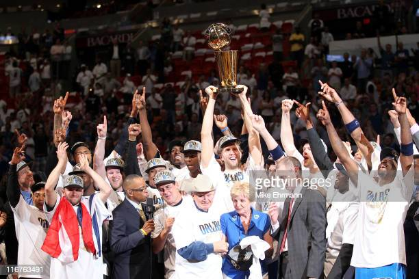 Finals MVP Dirk Nowitzki of the Dallas Mavericks celebrates with the Larry O'Brien Championship trophy along with Brendan Haywood Caron Butler and...