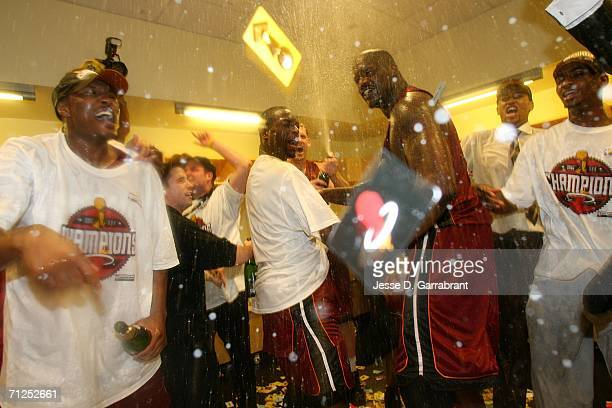 Finals MVP Dwyane Wade and Shaquille O'Neal of the Miami Heat celebrate in the locker roon after winning the NBA Championship against the Dallas...