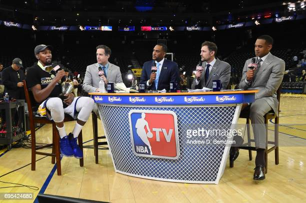 Finals MVP Kevin Durant of the Golden State Warriors talks to the NBATV broadcasting team after winning the NBA Championship in Game Five of the 2017...
