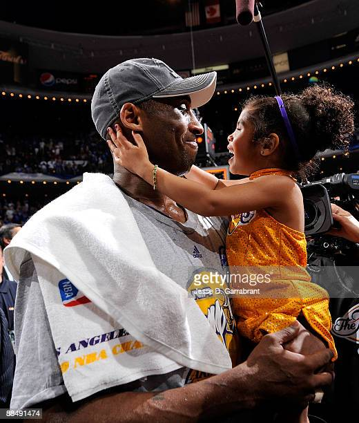 Finals MVP Kobe Bryant of the Los Angeles Lakers celebrates daughter Gianna after the Lakers won 99-86 to win the NBA Championship against the...
