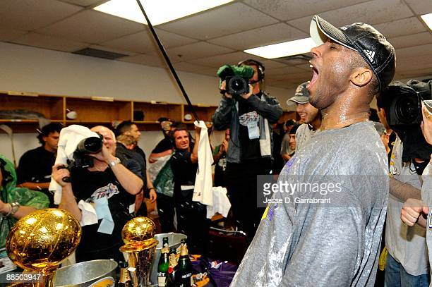 Finals MVP Kobe Bryant of the Los Angeles Lakers celebrates in the locker rooom after their 9986 win to win the NBA Championship against the Orlando...