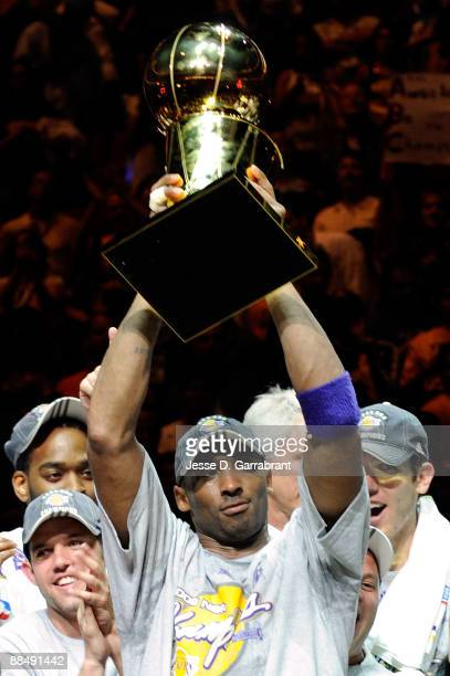 Finals MVP Kobe Bryant of the Los Angeles Lakers holds up the Larry O'Brien trophy after the Lakers won 9986 to win the NBA Championship against the...