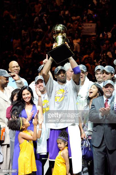 Finals MVP Kobe Bryant of the Los Angeles Lakers holds up the MVP trophy as he celebrates with his wife Vanessa and daughters Gianna and Natalia...