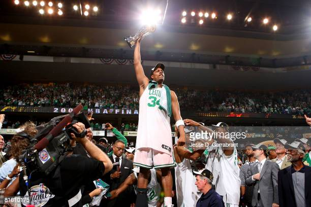 Finals MVP Paul Pierce of the Boston Celtics celebrates with the MYP trophy after the Celtics won 13192 against the Los Angeles Lakers to winthe NBA...