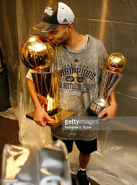 Finals MVP Tony Parker the San Antonio Spurs celebrates in the locker with the Larry O'Brien Championship trophy and his MVP trophy after their 8382...