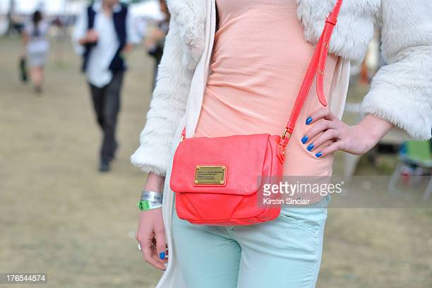 Finance Analyst Elina Tim wears a Marc by Marc Jacobs bag, Hobbs jeans, All Saints vest and cardigan, Vintage jacket on day 4 of Wilderness Festival...