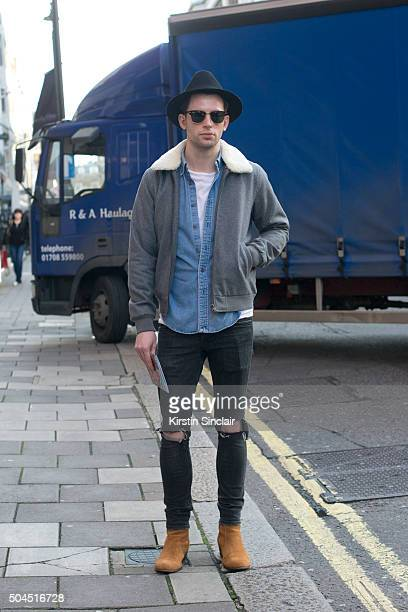 Finance executive James Lewis wears a ASOS jacket vintage Ralph Lauren jacket All Saints jeans Everyday Hero boots Failsworth hat and Ray Ban...