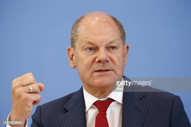 Finance Minister and vice Chancellor, Olaf Scholz , gestures as he speaks during a press conference on the Federal Budget Supplement on June 17, 2020...