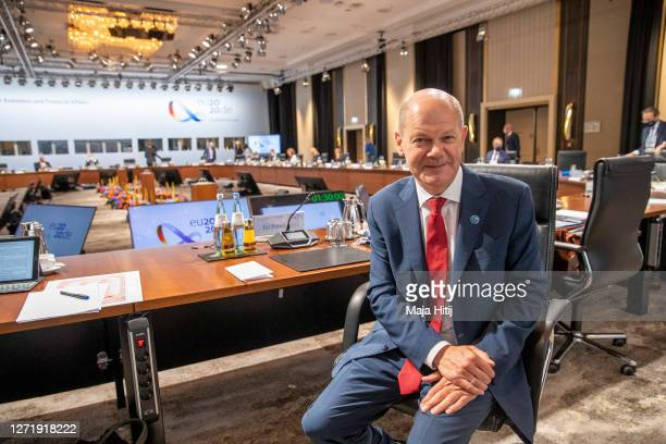 Finance minister and vice Chancellor Olaf Scholz sits during an informal meeting of European Union ministers for economic and financial affairs on...