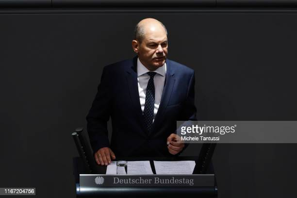 Finance Minister and vice Chancellor, Olaf Scholz speaks during the first session after summer Vacation of the German Parliament,or Bundestag, which...