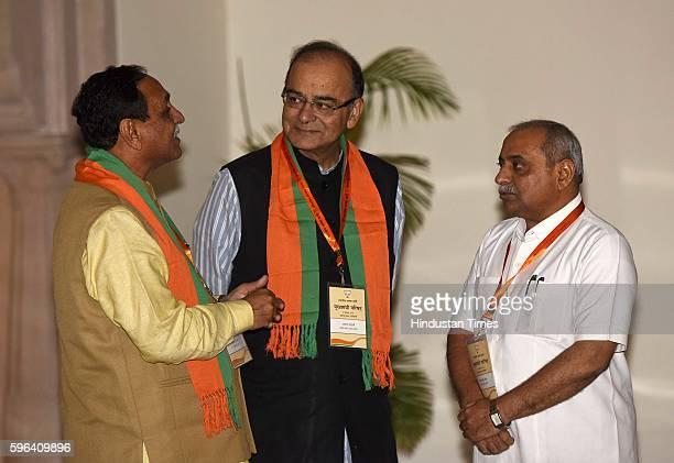 Finance Minister Arun Jaitley talking to Chief Minister of Gujarat Vijay Rupani, Deputy CM of Gujarat Nitin Patel during the meeting of BJP Chief...