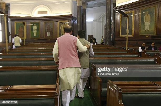 Finance Minister Arun Jaitley talks to Congress leader Rajeev Shukla during the winter session at the central hall of the parliament house on...