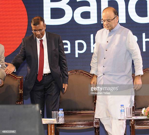 Finance Minister Arun Jaitley with Bandhan Bank Founder MD CEO Chandra Sekhar Ghosh and West Bengal Finance Minister Amit Mitra during an...