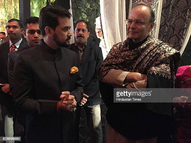 Finance Minister Arun Jaitley with BCCI President Anurag Thakur during the wedding reception of Indian Cricketer Yuvraj Singh and Bollywood actor...
