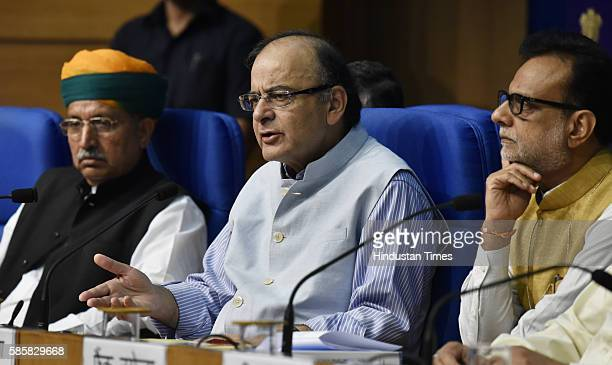 Finance Minister Arun Jaitley with his deputy Arjun Ram Meghwal and Revenue Secretary Hasmukh Adhiya addresses a press conference a day after Goods...